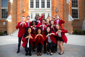 Some of the 2019-2020 College of Arts and Sciences ambassadors making heart hands.